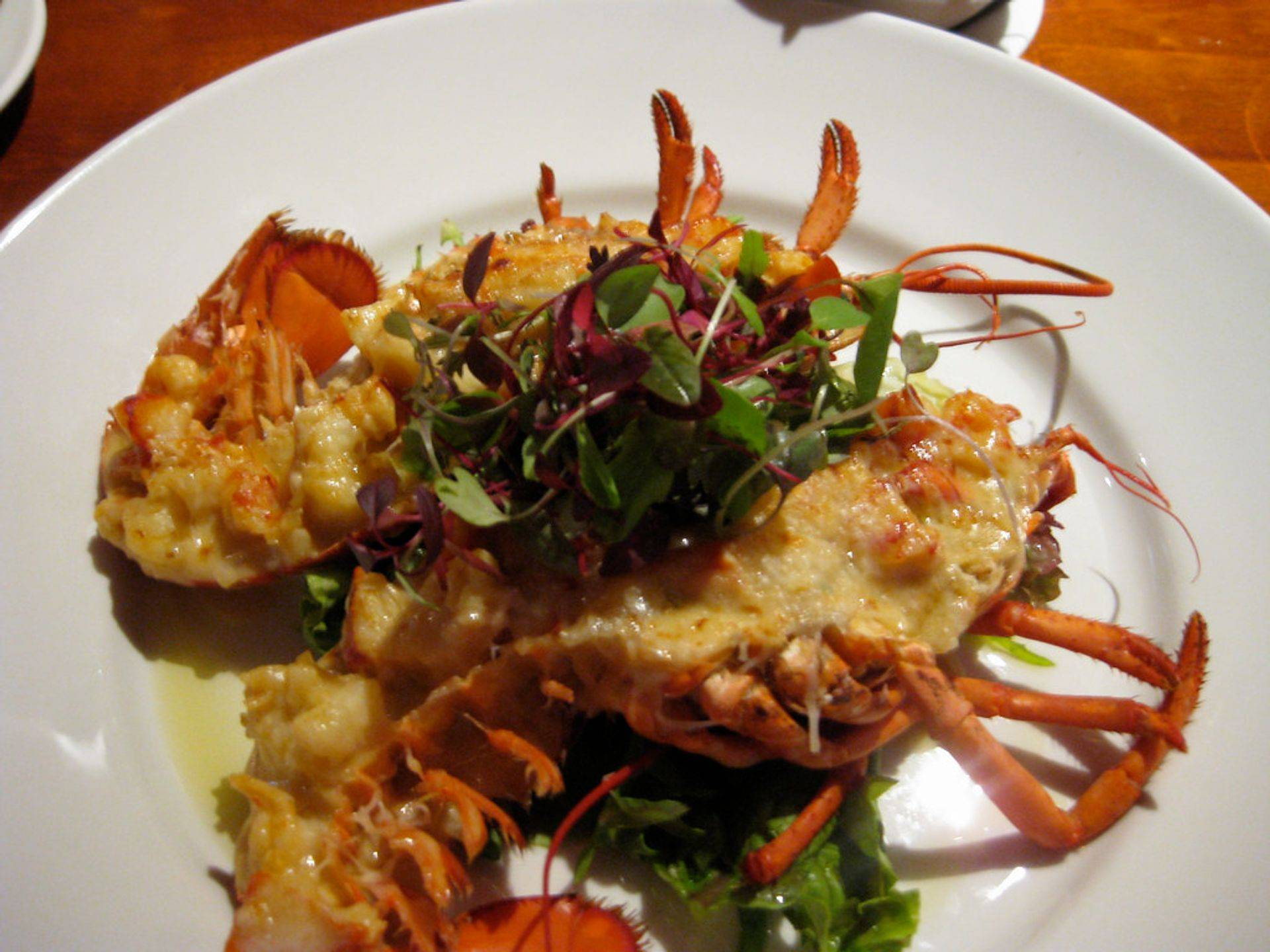 Seafood dishes served with delicious sides at Figaro