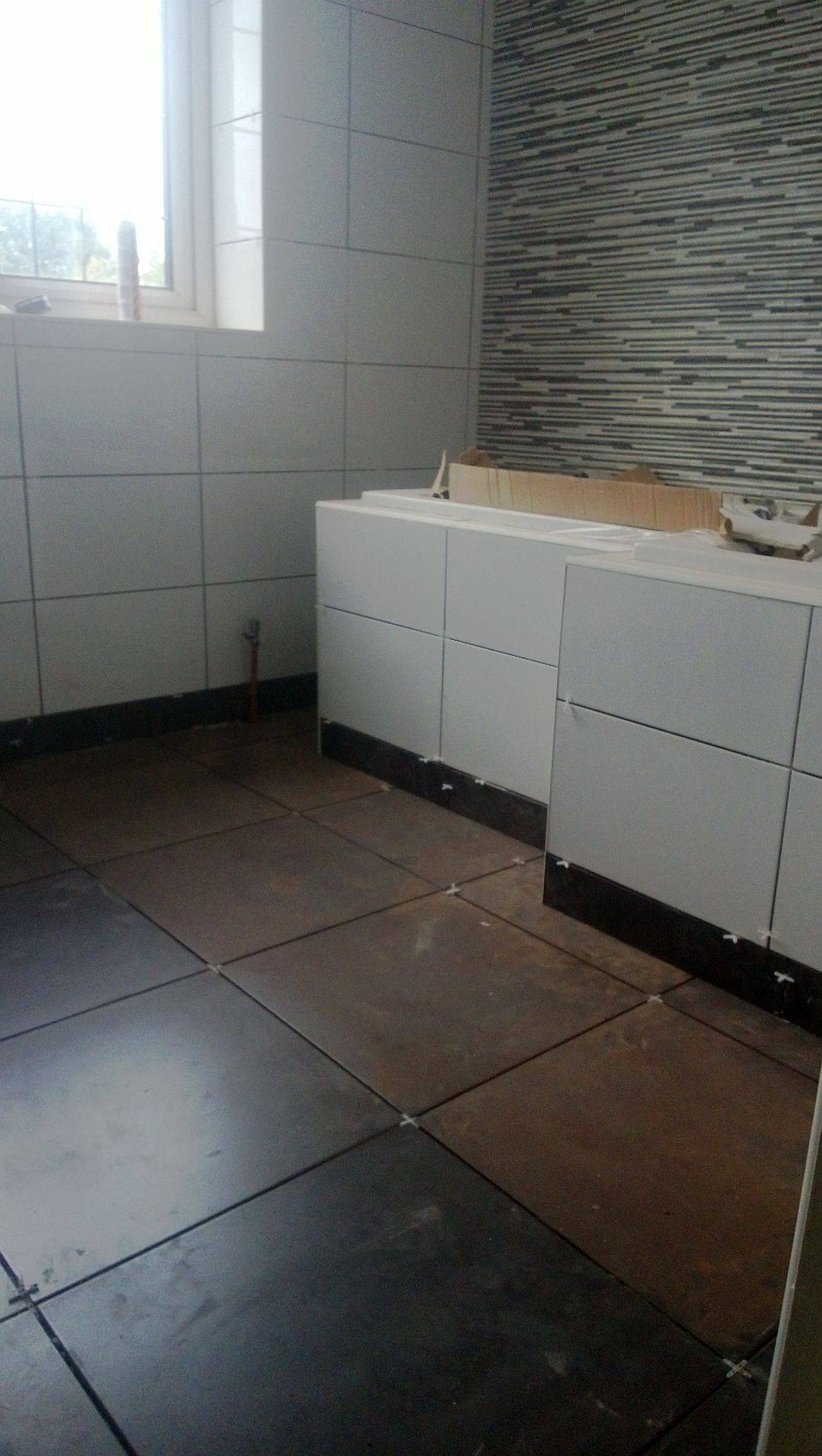 Bathroom fully tiled and cement board subfloor used.