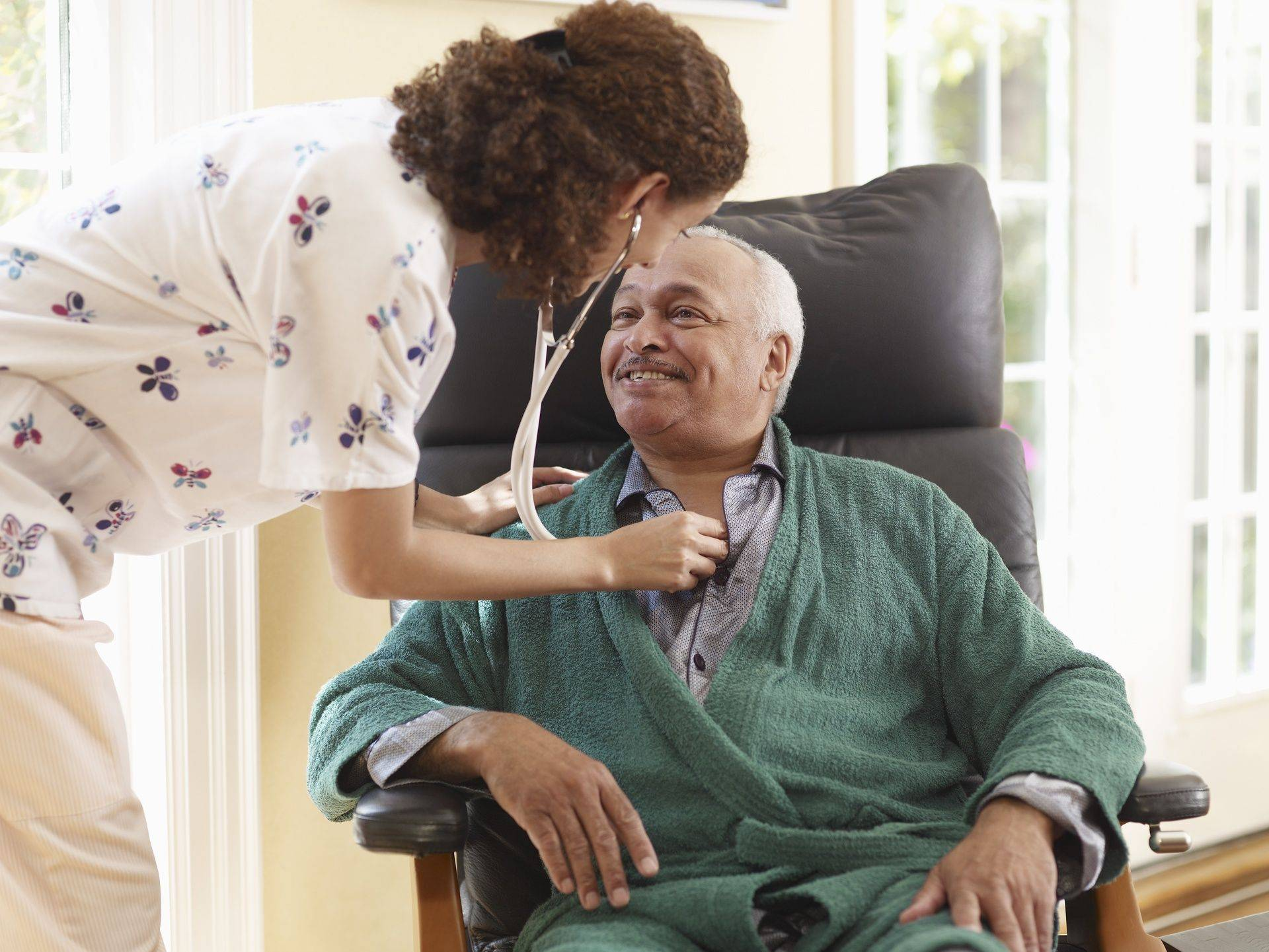 Nurse assisting the elderly man, companion care