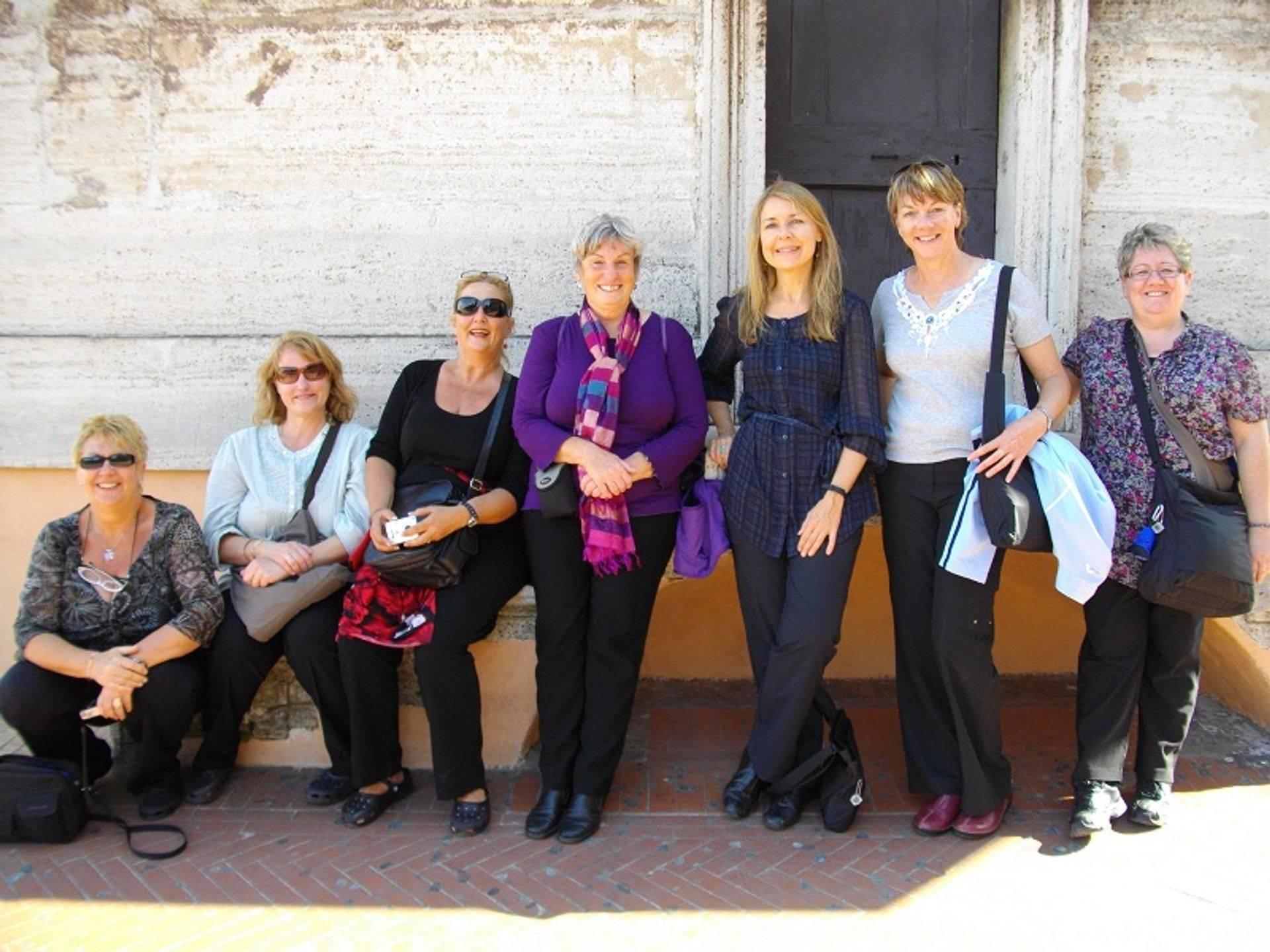 alt= Travel group Vatican rooftop.