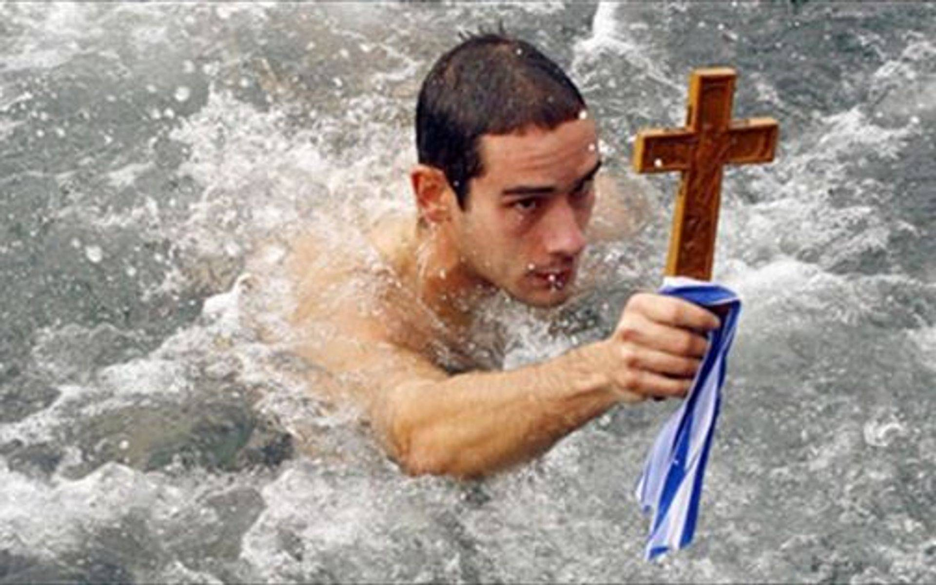 Epiphany tradition, diving in the Frozen waters fro the Cross, as the Greek Orthodox tradition says