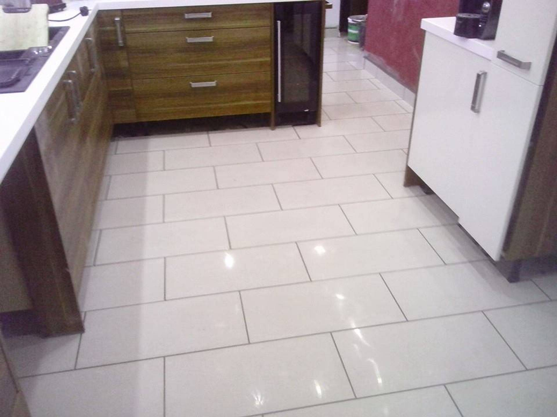Tiling of kitchen floor in wordsley, self leveled and tiled finish.