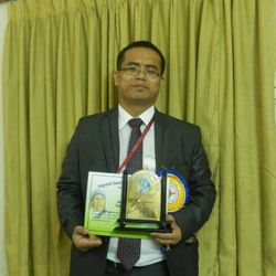 DR.P.MANGTE WITH HIS AWARD