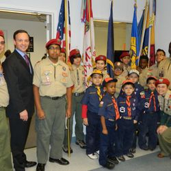 Pack and Troop 371 poses with the Islip Town Supervisor after having presented the colors for the Town of Islip's Black History Month Celebration.