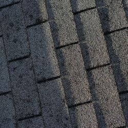 Severe hail damage to the shingles, perfect example of where leaks develop in the future.