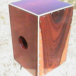 Padouk and mahogany string cajon with maple corner binding. $599