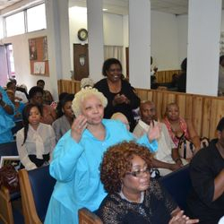Mother Marie Roberts in blue in worship service