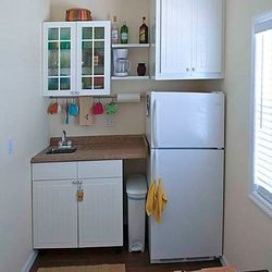 Sink, Fridge, plates, cups, etc.