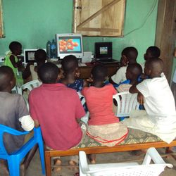 Children boarding at school watching a film