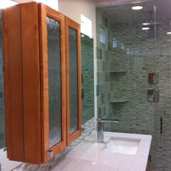 Custom hand built cabinetry, all tiled shower with multiple shower heads with sleek faucets makes this a spa like feel every use.