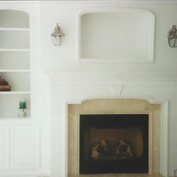 Light & bright modern fireplace and wall of bookcases