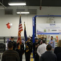 "Cadets perform a Color Guard in support of ""Keys to Progress"", a charity event that awards newly refurbished vehicles to worthy veterans."