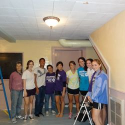 Painting a house for the United Way Days of Caring.