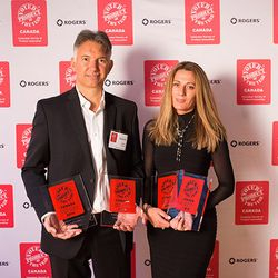 Rado Miljkovich & Ratka Miljkovich accepting their four Product of the Year Canada 2014 awards