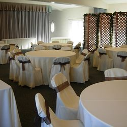 Cedar Lattice Panels with linens and chair covers/sashes