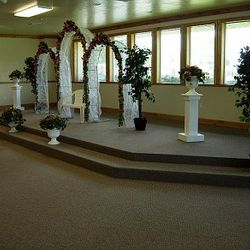 White Wedding Arches with added pedestals and greenery urns