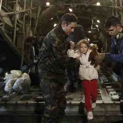little girl rescued, transferred to Greece by the C-130 Greek Airforce crew