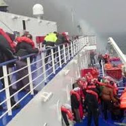 the flaming boat, while hundreds in agony wait to be rescued