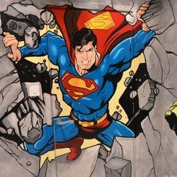 mural art superman smashing bursting busting through wall