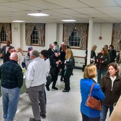 Supporters confer over refreshments at the Tewksbury Community Night