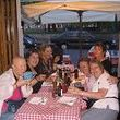 alt= Travel group dinner Rome, Italy.