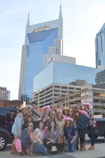 Lauren and friends with Batman Building in background