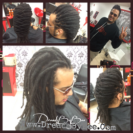 Natural Dreads Wrapped to create clean cut look.