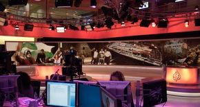 The busy news room for Al Jazeera in the UK
