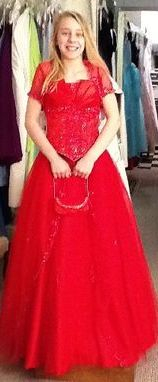 An elegant red puffed out dress.