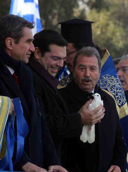 Alexis Tsipras, Epiphany Day, waiting during the Orthodox ceremony to let the pigeon fly at the Holy blessing of the waters