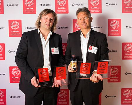 Darko Radomir & Rado Miljkovich accepting their four Product of the Year Canada 2014 awards